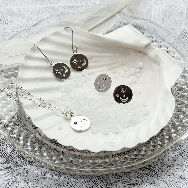 Matching jewellery set: moon and stars designs in sterling silver with marcasite gemstones.