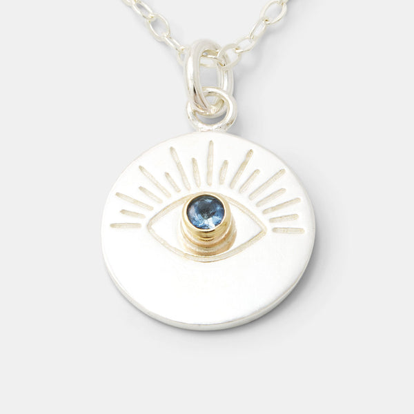 Necklace with pendant in gold and silver, including our evil eye amulet.