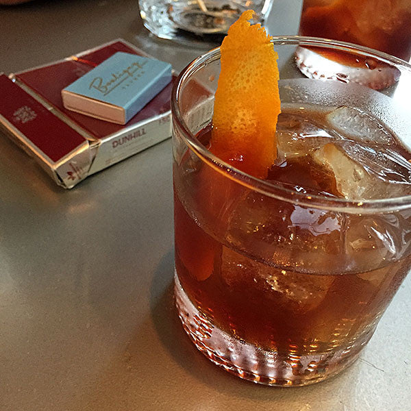 Enjoying an Old Fashioned cocktail in Magazine Street, New Orleans.