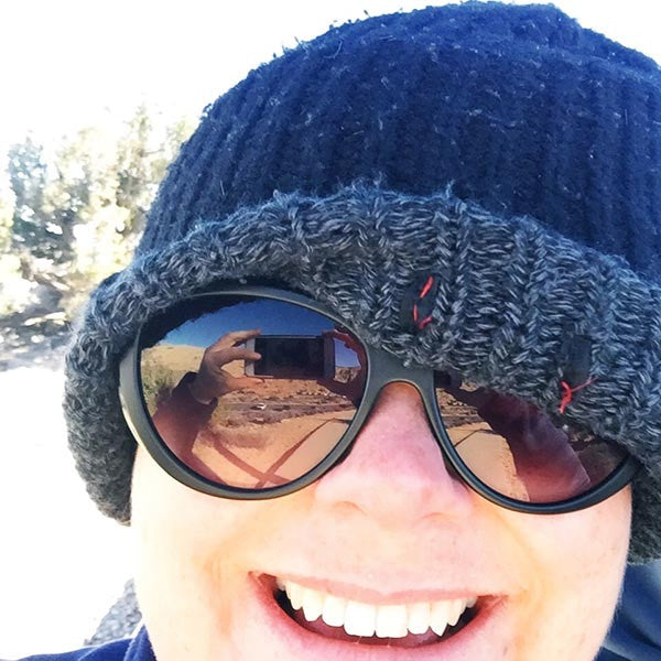 Simone Walsh almost being blow away on a freezing cold mountain in Joshua Tree, California.