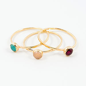 Solid gold stacking rings with gemstones.