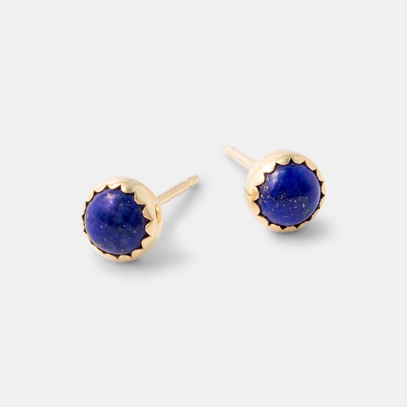 Solid gold stud earrings with lapis lazuli gemstones.