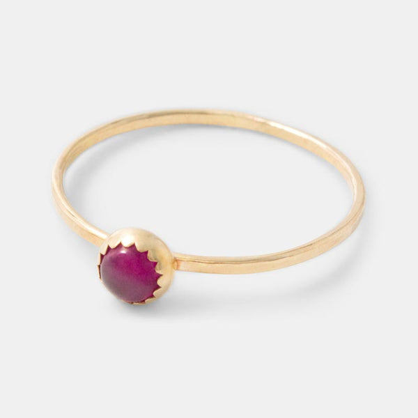 Solid gold and ruby stacking ring in our handmade jewelry online shop.