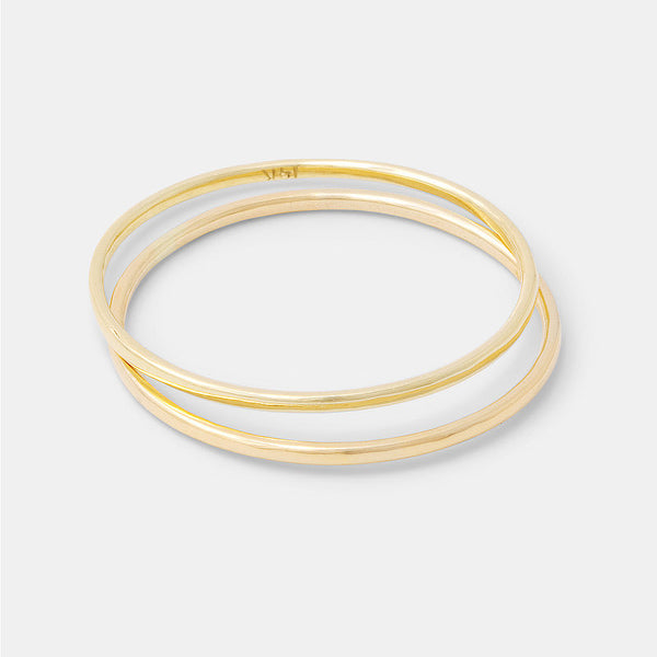 Solid gold skinny stacking rings set handmade by Australian jeweller Simone Walsh.