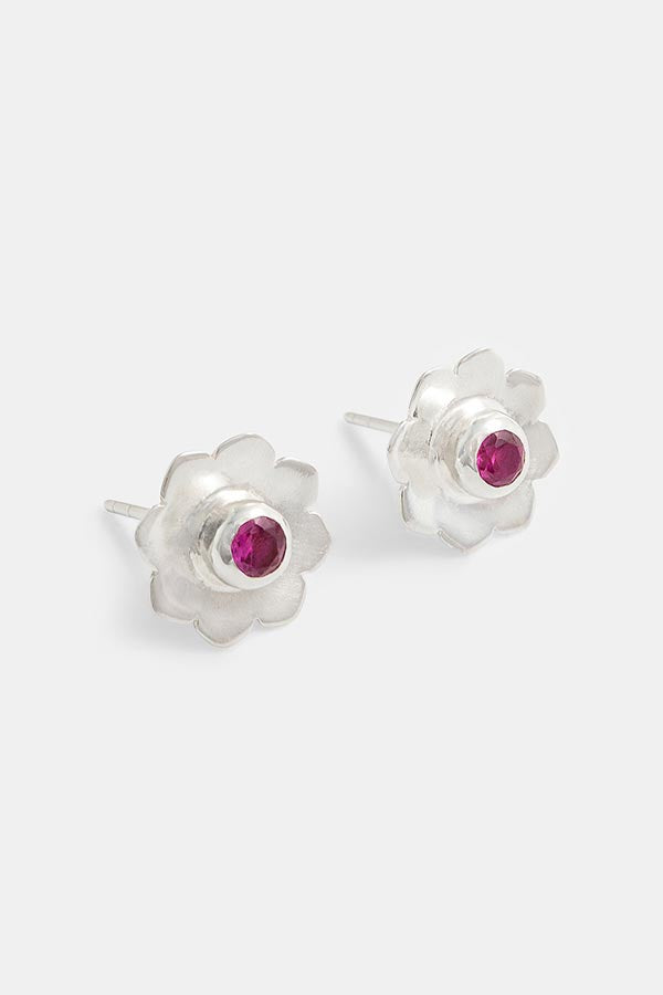 Beautiful handmade earrings: sterling silver stud earrings with ruby gemstones in a mandala flower design: a perfect pop of pink jewellery. Created by Australian jewellery designer Simone Walsh.