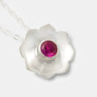 Sterling silver pendant necklace with a mandala flower design and a ruby gemstone by Australian jeweller Simone Walsh.