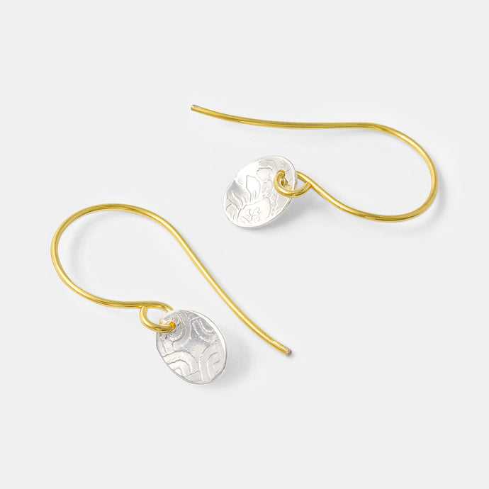 Unique gold and sterling silver drop earrings with patterned ovals handmade by Australian jewellery designer Simone Walsh.