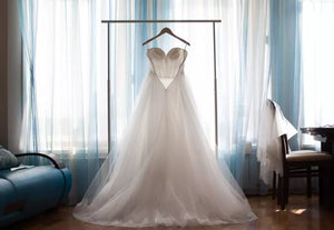 What is the best way to store a wedding dress?