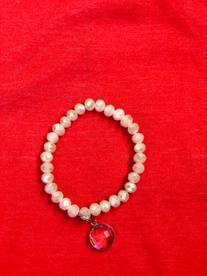 White beaded bracelet with charm