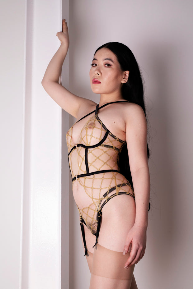 Studio Pia Jalsa thong in black and gold