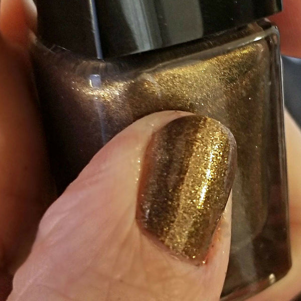 Close Up | Captain Black Bart | Artisan Nail Polish by Atlantic Elixir | A luxurious gold and bronze with a a dark undertone
