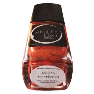 Devil's Paintbrush | Artisan Nail Polish by Atlantic Elixir | Various variations in color, including red, orange, and yellow tones with an underlying black stem. So here's The Devil's Paintbrush in a bottle!