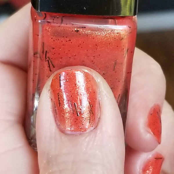 Close up | Devil's Paintbrush | Artisan Nail Polish by Atlantic Elixir | Various variations in color, including red, orange, and yellow tones with an underlying black stem. So here's The Devil's Paintbrush in a bottle!