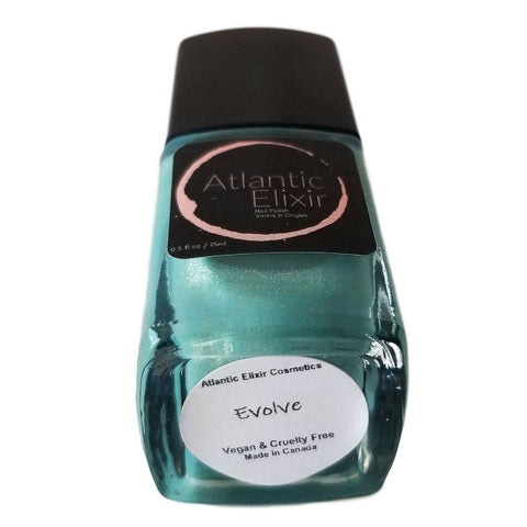 Evolve | Artisan Nail Polish by Atlantic Elixir | A golden turquoise. This airy cool shade reminds us of a mermaid... you too, can evolve!