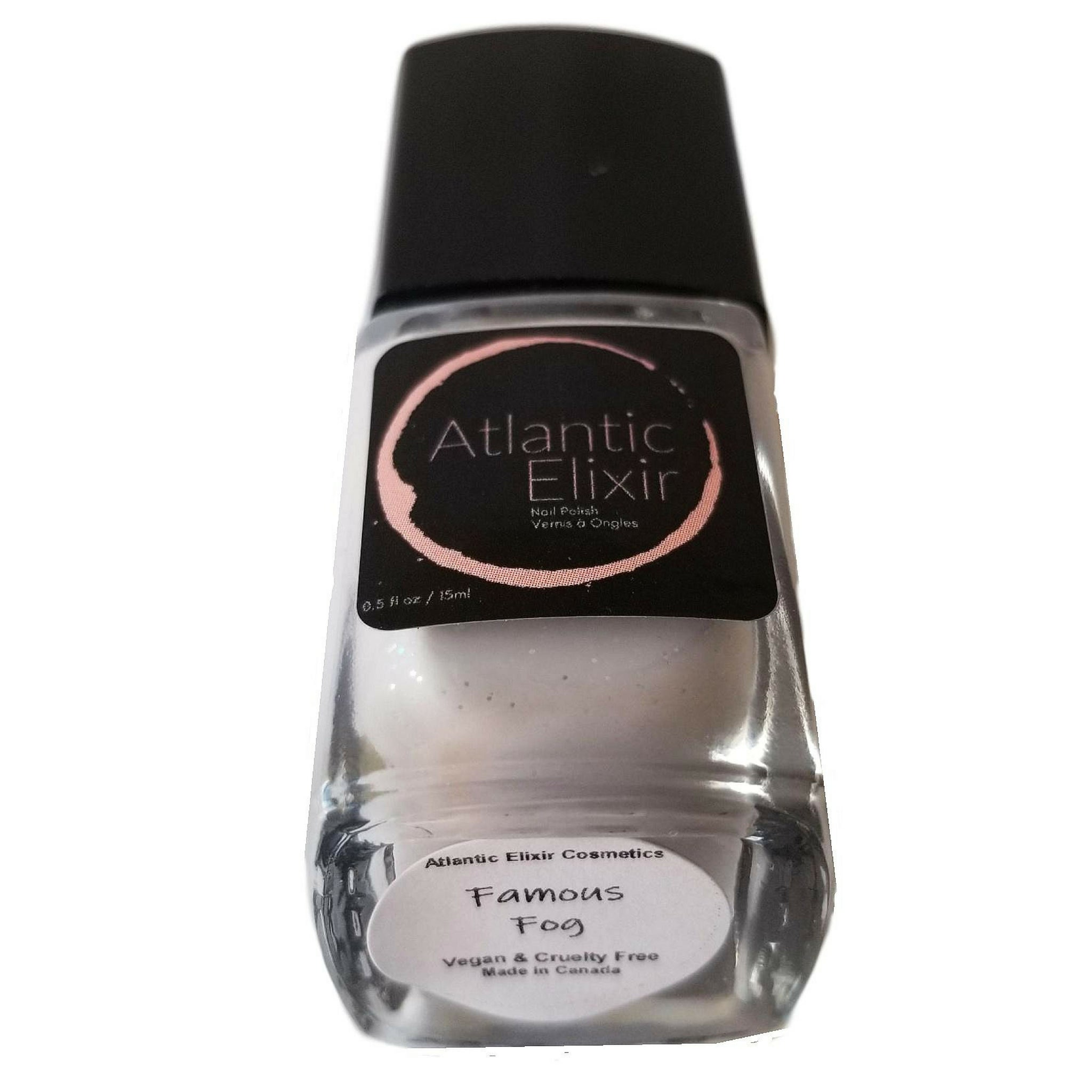 "Famous Fog | Artisan Nail Polish by Atlantic Elixir | A pale ""grayish lavender"" shade with a pop of iridescent gold and green sparkle."