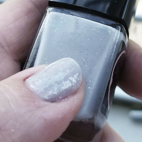 "Close up | Famous Fog | Artisan Nail Polish by Atlantic Elixir | A pale ""grayish lavender"" shade with a pop of iridescent gold and green sparkle."