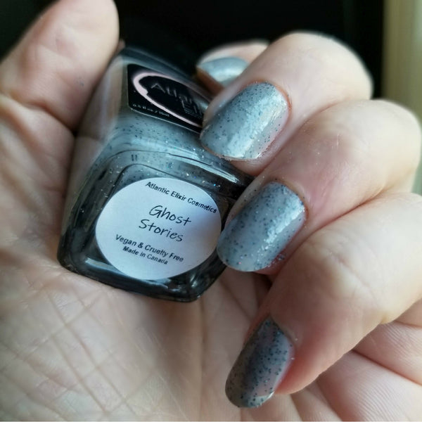 On Nails | Ghost Stories | Artisan Nail Polish by Atlantic Elixir Cosmetics | A pale and almost translucent cool gray with extraordinary orbs of holographic color changing sparkle!