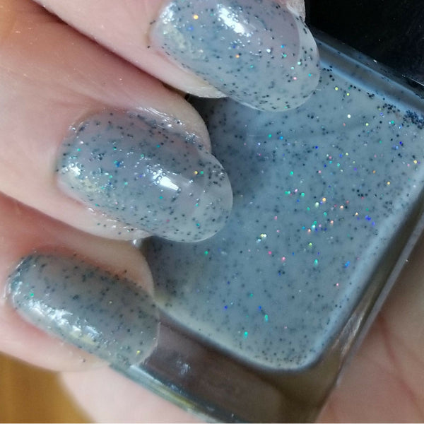 Close Up | Ghost Stories | Artisan Nail Polish by Atlantic Elixir Cosmetics | A pale and almost translucent cool gray with extraordinary orbs of holographic color changing sparkle!