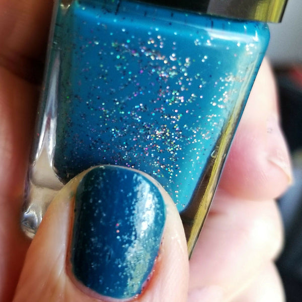 Close Up of Label | Sea Glass | Artisan Nail Polish by Atlantic Elixir | A deep oceanic blue tone with holographic flecks of golds, greens, icy blues and pinks.