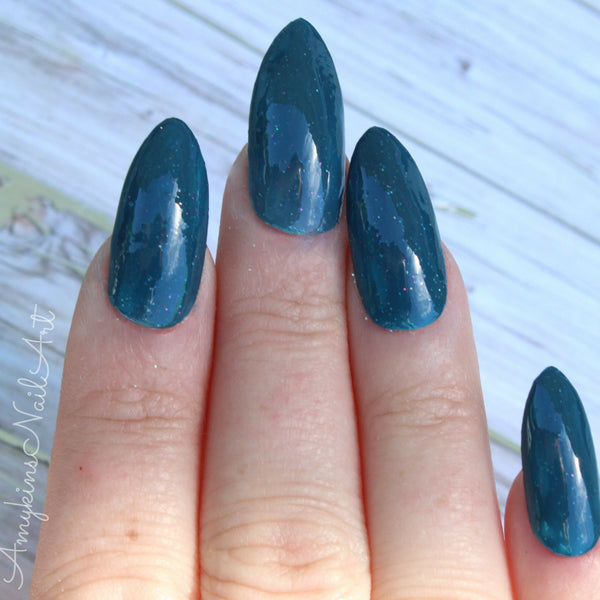 Amykins Nail Art | Sea Glass | Artisan Nail Polish by Atlantic Elixir | A deep oceanic blue tone with holographic flecks of golds, greens, icy blues and pinks.