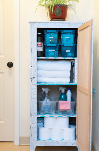 standing cabinet with linen and bathroom supplies