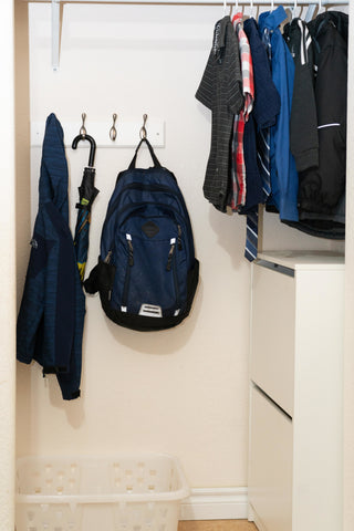 bedroom closet with laundry basket and shoe storage