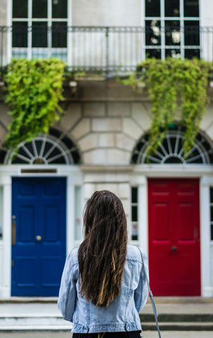 woman choosing between blue door and red door