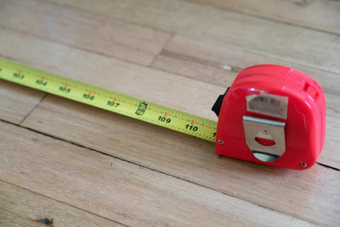 tape measure on hardwood floor