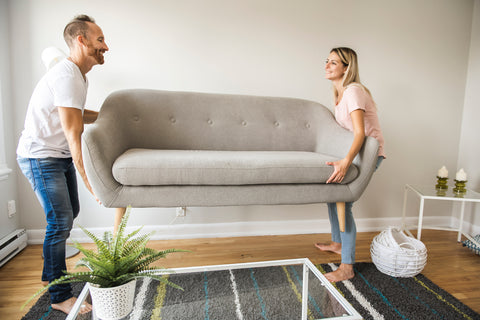 couple moving a couch