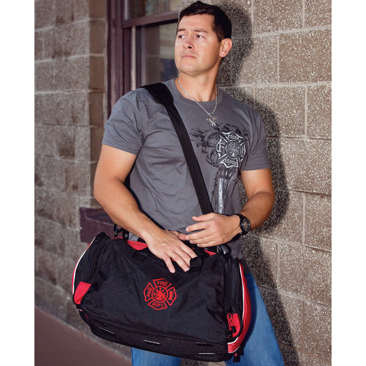 Firefighters over night duffel bag