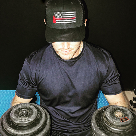 Firefighter at Gym Wearing Thin Red Line Axe Flag Richardson Hat