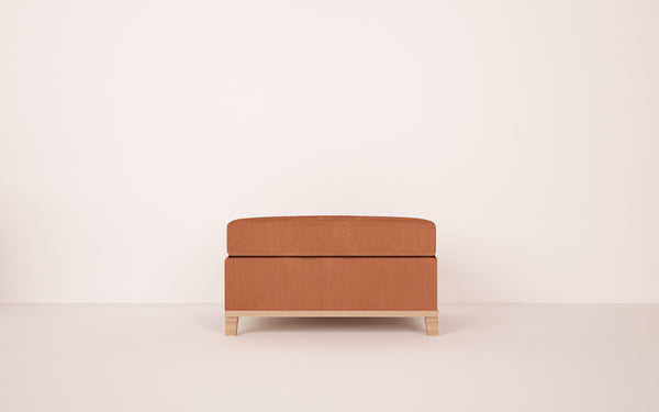 Topaz Ottoman in Clever Cotton