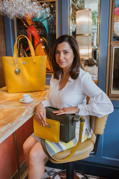 Creative Director and designer Giovanna Sessi-Knott holding a green pepper & mustard Morphbag