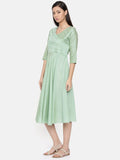 Overlap style green dress with pleat and cut-work embroidery detailing - AS0258 - Asmi Shop
