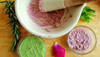 Coloured herb skincare in white cermic mortar and pestle