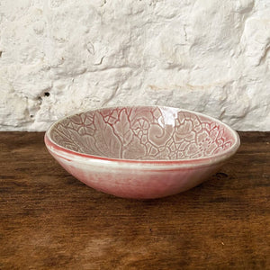 This small porcelain copper red Brewery Pottery bowl is handmade from a slab of clay textured with vintage lace. When in the kitchen, we love and use these little catch all ceramics bowls for salsas, dips, hummus, ice cream, small snacks, and even those tiny leftovers.