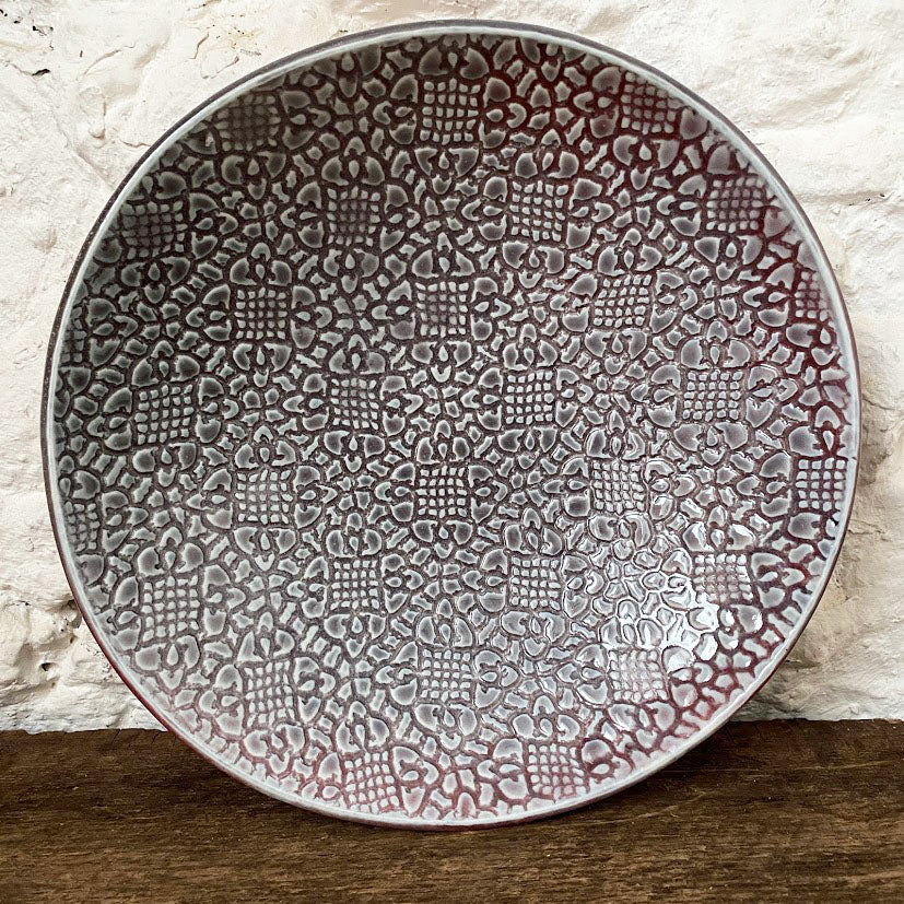 Handmade porcelain blate...a perfect combination of a bowl and a plate. A mixture of blue and red in color it makes a perfect home for loving cooked meals to enjoy around your table. Made with love at Brewery Pottery.