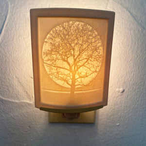 These delicately detailed porcelain night lights are a great addition to any room in the house. Use it in the hall or by the stairs as a safety light at night. Light up the bathroom with its soft glow. Change baby's diaper in the middle of the night by its gentle light. Use this ceramic light in the kitchen as a beacon to your midnight snack.