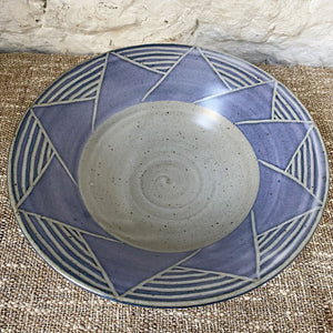 Thrown Brewery Pottery bowl with a blue hand carved  pattern. Using a handmade bowl is a great way to enjoy and enhance your favorite meals. Whether you're eating alone or serving a friends, using handmade ceramic bowl is a lovely way to showcase your beautifully prepared meal.