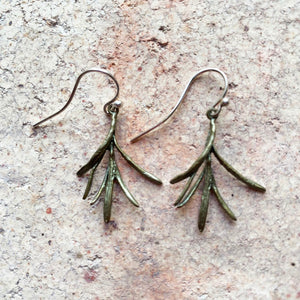 These Rosemary earrings are cast in bronze. The wires are 925 Sterling Silver. In ancient Greece Rosemary was thought to improve the mind and memory and later came to signify remembrance.
