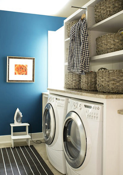A bright blue laundry room accent wall painted with Blue Danube 2062-30.