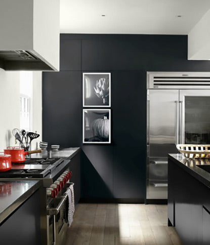 A slick, black kitchen accent wall painted in Black Tar 2126-10.