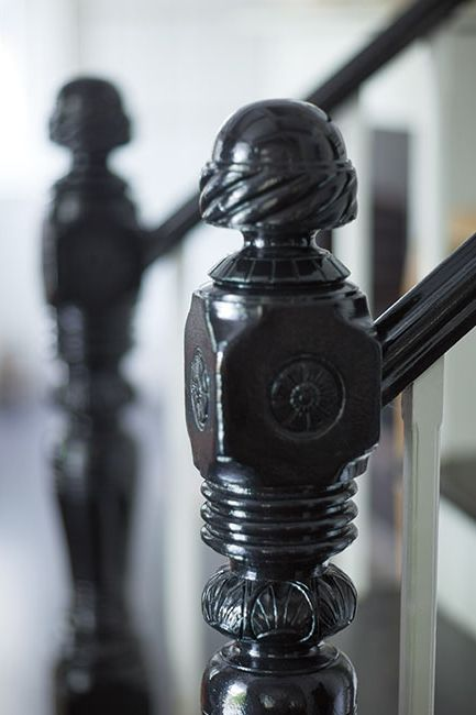 Stairway handrail painted in Black Satin paint color