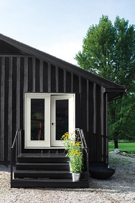 House exterior painted in Black Satin Regal Select Paint color