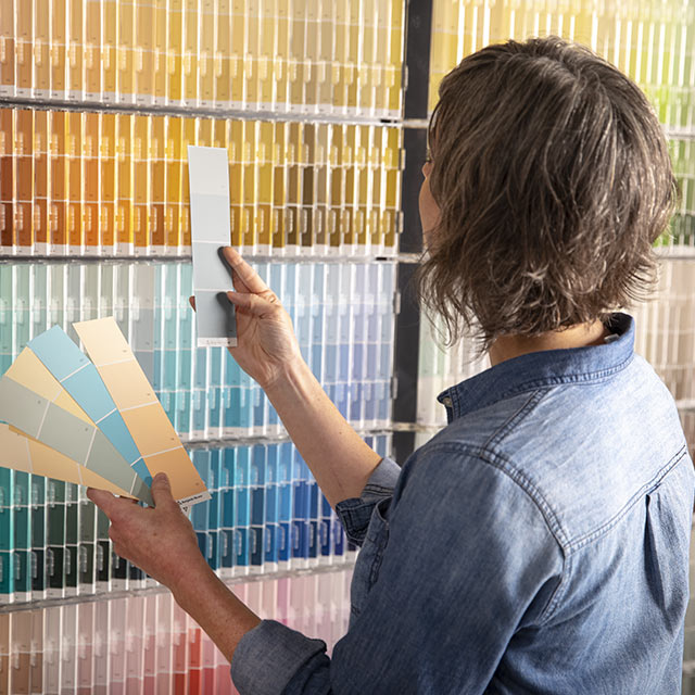 Woman inspecting various paint swatches