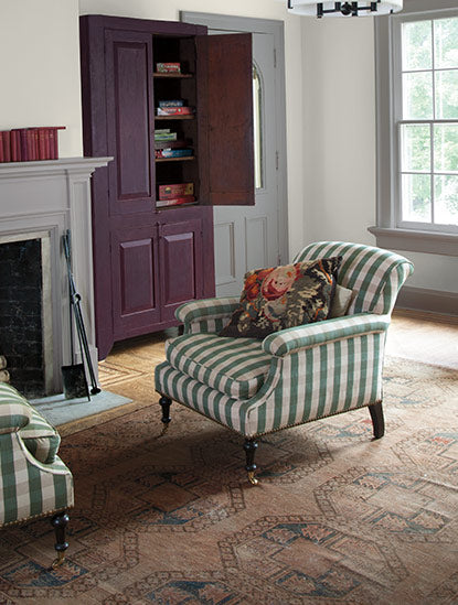 Two distinct gray paint colors yield different undertones in a traditional family room.