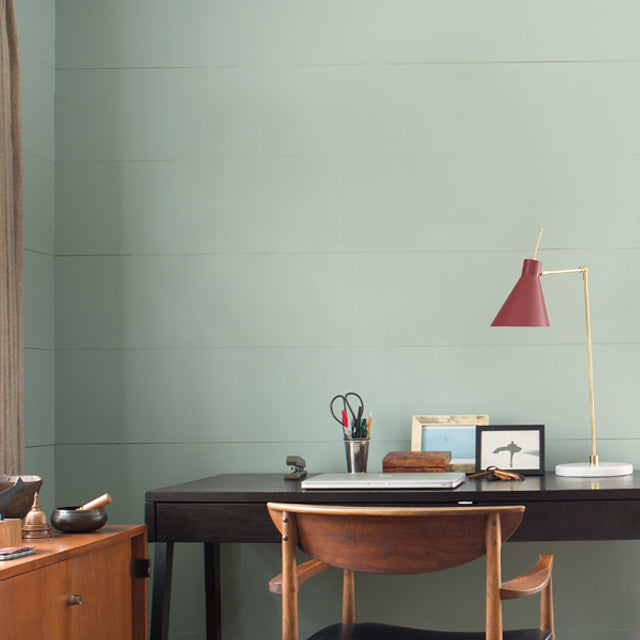 Home office walls painted in a silver blue paint color
