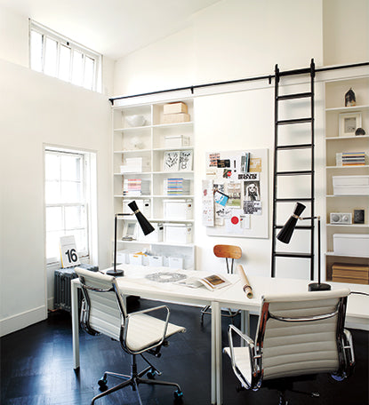 Bright home office painted in white paint