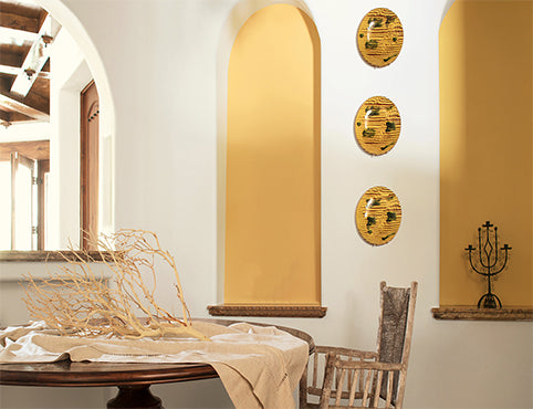 An elegant dining area in yellow wall accents.