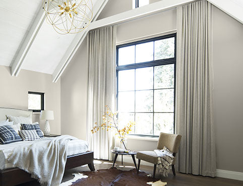 Neutral bedroom painted in Wish AF-680 with white cathedral ceiling in Baby's Breath OC-62.